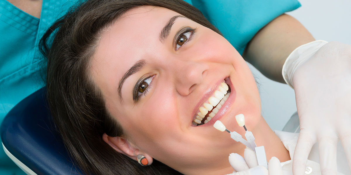 woman smiling after getting dental cosmetic bonding