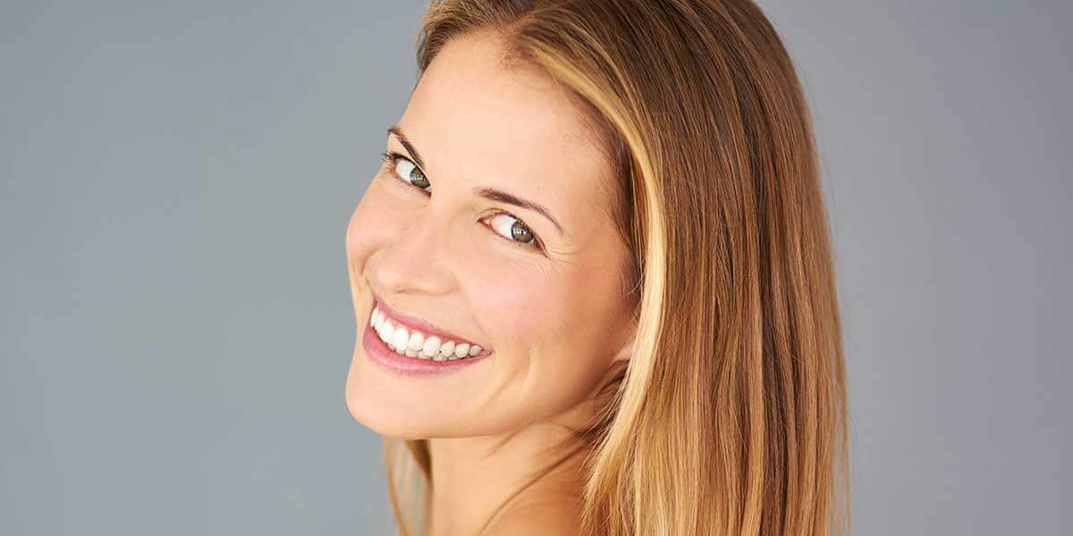 woman with straight white teeth smiling