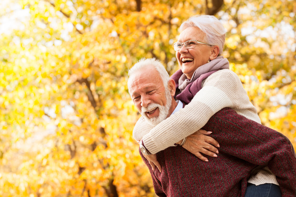 Senior couple with dentures smiling and laughing