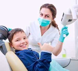 Young child receiving dental examination.
